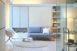 A Murphy Bed by Clei Compact Living Solutions which folds down over the sofa.