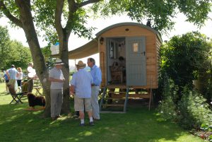 A summer gathering with a Blackdown shepherd's Hut.
