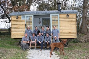 The Blackdown team with Ronnie B., a Rhodesian Ridgeback, charged with quality control for all snacks consumed on the premises.