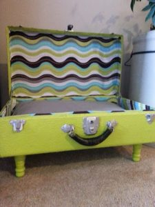 "A mid-century modern take on a ""suitcase bed"" from Reclaim Dames at Etsy."